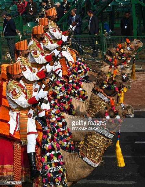 India's Border Security Force camels contingent take part in the full dress rehearsal for the upcoming Indian Republic Day parade in New Delhi on...