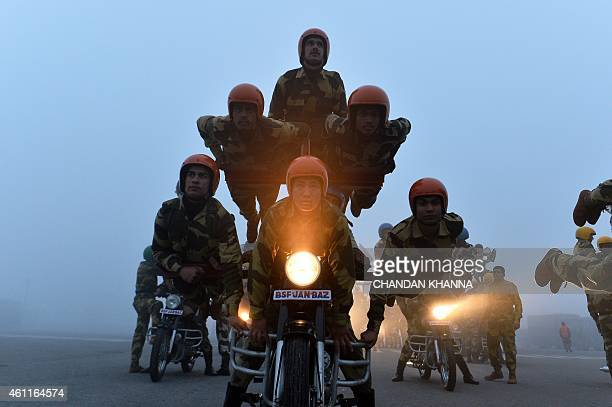 India's Border Security Force Daredevils motorcycle riders get ready during a rehearsal for the forthcoming Republic Day parade on a foggy winter...