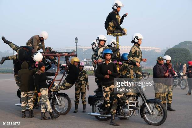India's Border Security Force quotDaredevilsquot women motorcycle practice formation during a rehearsal for the Republic Day parade on a cold winter...