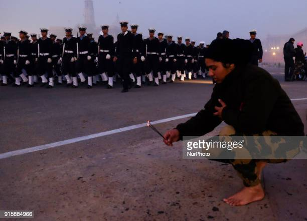 "India's Border Security Force ""Daredevils"" women motorcycle rider lights an incense stick at Vijay Chowk as forces gather to rehearse for..."