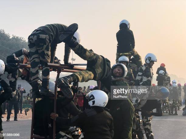 "India's Border Security Force ""Daredevils"" women motorcycle riders help their colleague to balance on a bike during a rehearsal for the..."