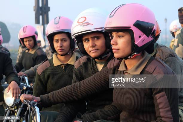 "India's Border Security Force ""Daredevils"" women motorcycle riders sit in formation during a rehearsal for the Republic Day parade on a..."