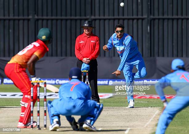 India's bowler Axar Patel plays a shot during the third and final ODI cricket match between India and Zimbabwe at the Harare Sports Club on June 15...