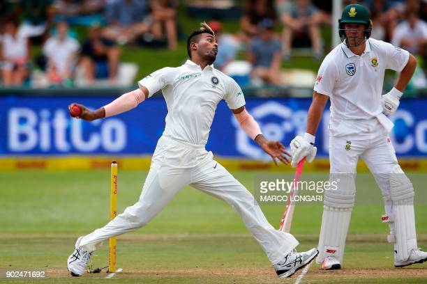 India's bowler Hardik Pandya delivers a ball during the fourth day of the first Test cricket match between South Africa and India at Newlands cricket...