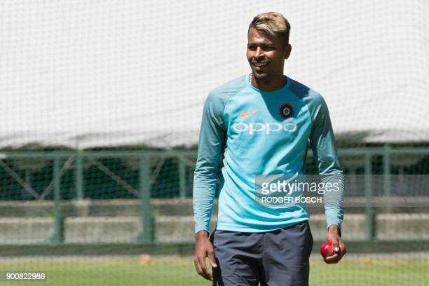 India's bowler Hardik Pandya looks on as he takes part in training session at the Newlands Cricket ground on January 3 in Cape Town prior to the...