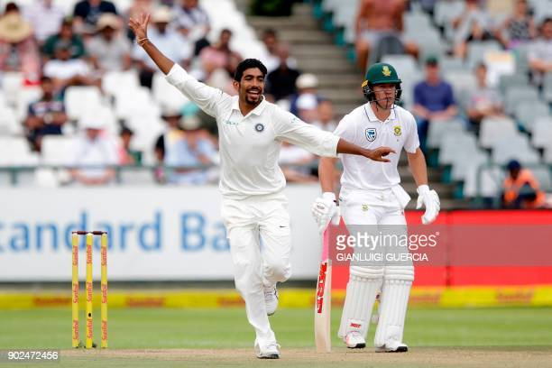 India's bowler Jasprit Bumrah celebrates the dismissal of South African batsman Quinton de Kock during the fourth day of the first Test cricket match...