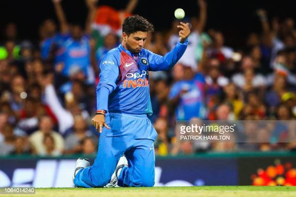 TOPSHOT India's bowler Kuldeep Yadav celebrates the caught and bowled wicket of Australia's Chris Lynn during the T20 international cricket match...