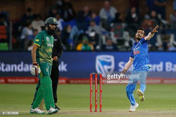 India's bowler Yuzvendra Chahal delivers a ball during the fifth one day international cricket match between South Africa and India at St George Park...