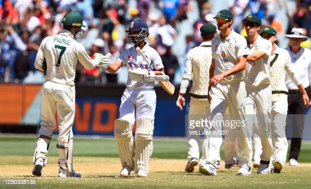 India's captain Ajinkya Rahane bumps fists with Australia's captain Tim Paine at the end of the second cricket Test match between Australia and India...