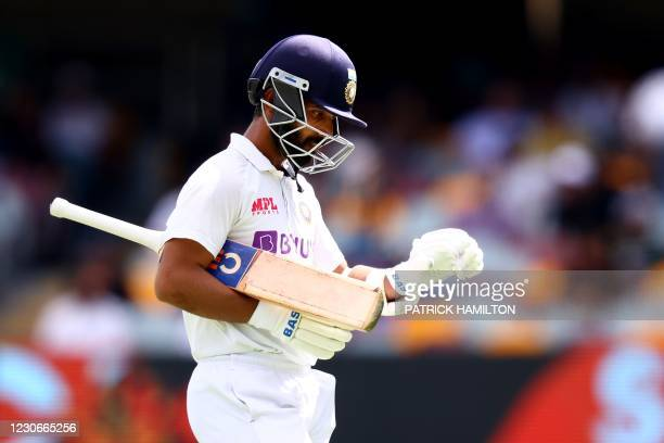India's captain Ajinkya Rahane departs after his dismissal on day five of the fourth cricket Test match between Australia and India at The Gabba in...