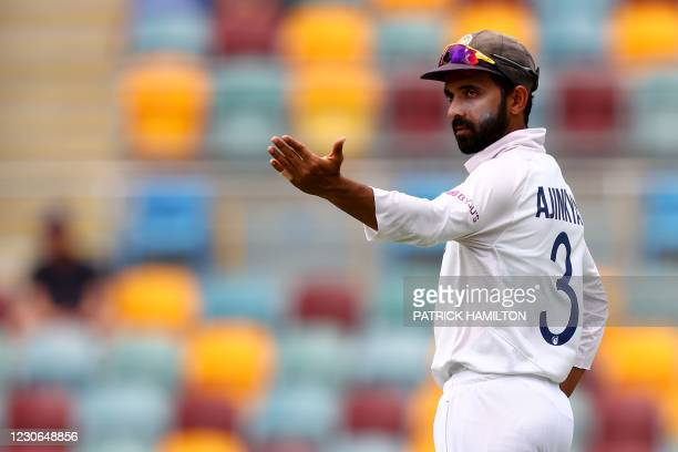 India's captain Ajinkya Rahane gives instructions to the fielders on day four of the fourth cricket Test match between Australia and India at The...