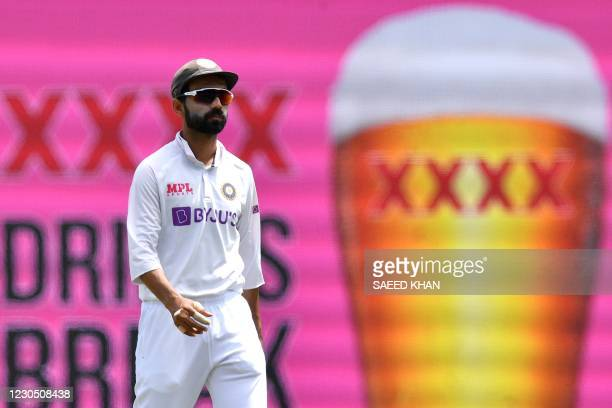 India's captain Ajinkya Rahane walks towards his fielding position during day four of the third cricket Test match between Australia and India at the...