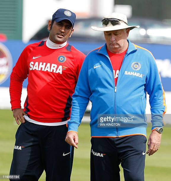 India's captain and wicketkeeper MS Dhoni talks with India's coach Duncan Fletcher on July 19, 2011 during a practice session at Lord's Cricket...