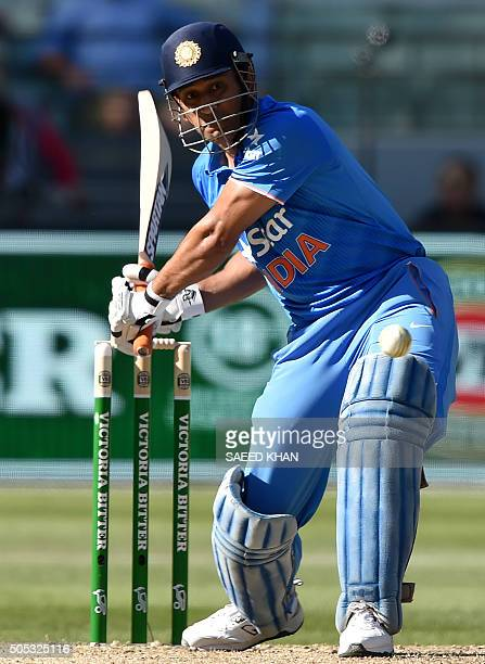 India's captain MS Dhoni plays a shot during the third oneday international cricket match between India and Australia at the MCG in Melbourne on...