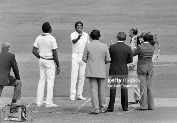 India's captain Kapil Dev tosses the coin watched by West Indies captain Clive Lloyd before the Prudential World Cup Final between India and West...