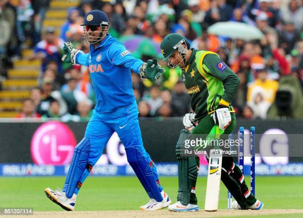 India's captain Mahendra Dhoni celebrates after Pakistan's MisbahulHaq is bowled by India's Ravindra Jadeja for 22 during the ICC Champions Trophy...