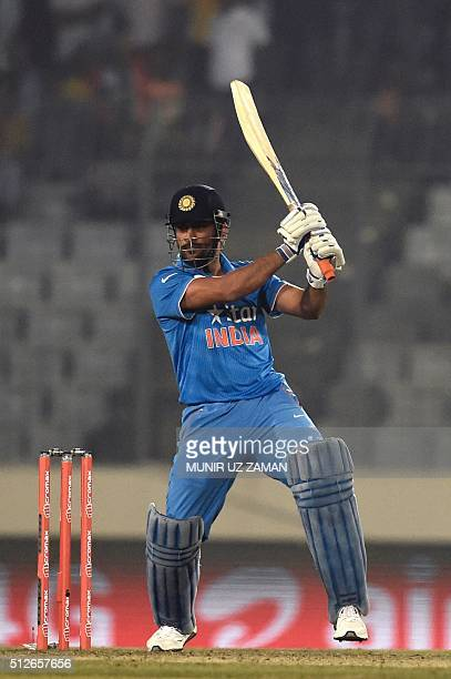 India's captain Mahendra Singh Dhoni plays a shot during the Asia Cup T20 cricket tournament match between India and Pakistan at the ShereBangla...