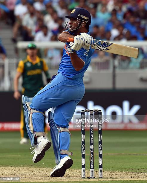 India's captain Mahendra Singh Dhoni plays a shot during the Pool B 2015 Cricket World Cup match between South Africa and India at the Melbourne...