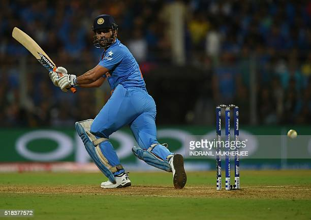 India's captain Mahendra Singh Dhoni plays a shot during the World T20 men's semifinal match between India and West Indies at The Wankhede Cricket...