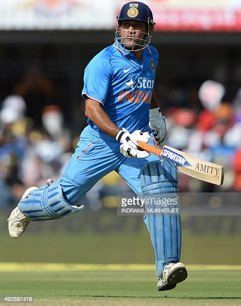 India's captain Mahendra Singh Dhoni runs during the second one day international cricket match between India and South Africa at The Holkar Cricket...