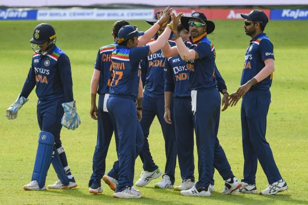 India's captain Shikhar Dhawan celebrates with his teammates after the dismissal of Sri Lanka's Bhanuka Rajapaksa during the first one-day...