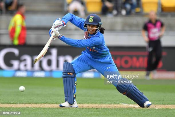 India's captain Smriti Mandhana plays a shot during the first Twenty20 international women's cricket match between New Zealand and India in...