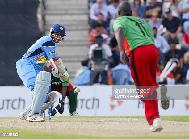 India's captain Sourav Ganguly appears to have the ball covered but is cleaned bowled by Kenya's Martin Suji in the ICC Champions Trophy match at the...