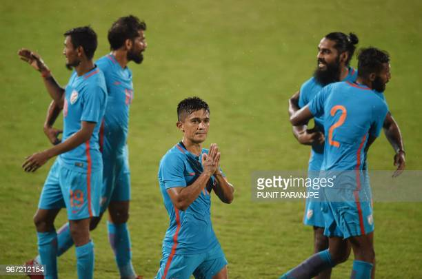 India's captain Sunil Chhetri greets his team's supporters after winning the Hero Intercontinental Cup football match between India and Kenya in...