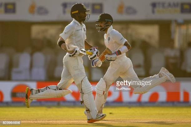 India's captain Virat Kohli and Abhinav Mukund run between the wickets during the 3rd Day's play in the 1st Test match between Sri Lanka and India at...