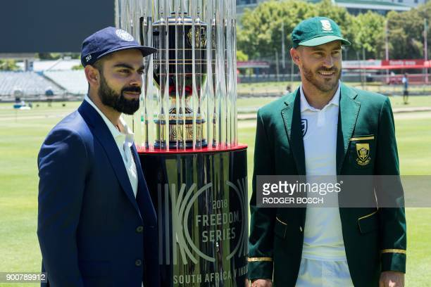 India's captain Virat Kohli and South Africa's captain Faf du Plessis pose with the 2018 Freedom Series trophy which will be won by the winner of...
