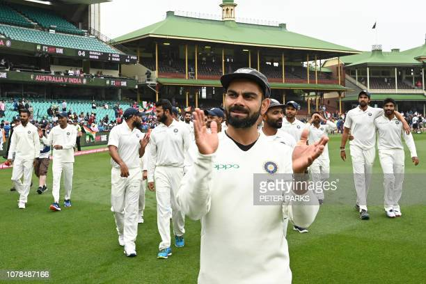 India's captain Virat Kohli applauds as the India team celebrates their series win on the fifth day of the fourth and final cricket Test against...