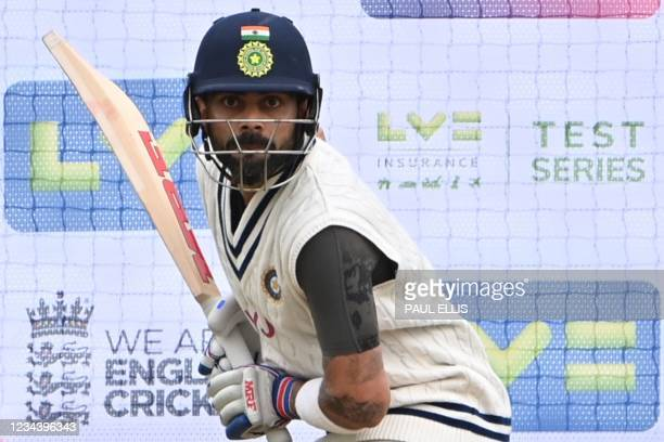 India's captain Virat Kohli bats in the nets during a training session at Trent Bridge Cricket Ground in Nottingham, central England on August 2,...