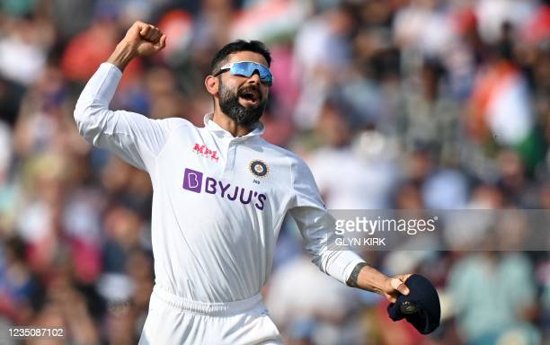 India's captain Virat Kohli celebrates after England's Chris Woakes was dismissed during play on the fifth day of the fourth cricket Test match...