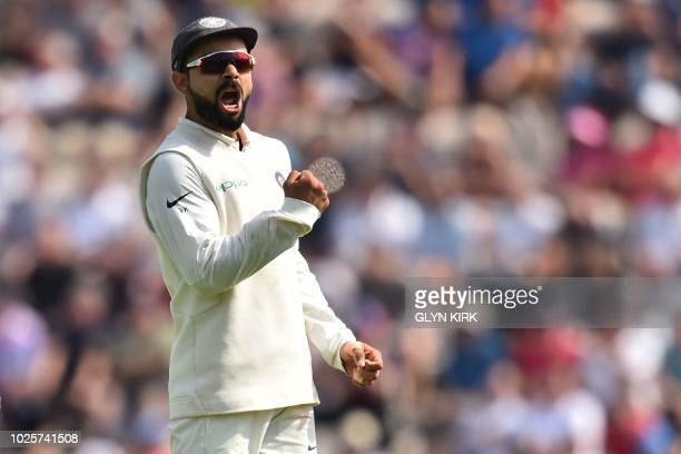 India's captain Virat Kohli celebrates after England's Keaton Jennings loses his wicket during play on the third day of the fourth Test cricket match...