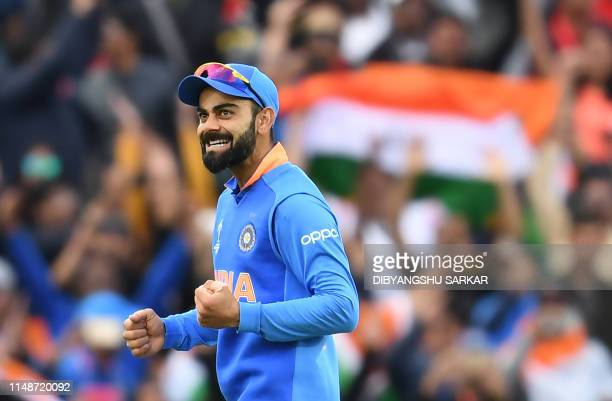 India's captain Virat Kohli celebrates after victory in the 2019 Cricket World Cup group stage match between India and Australia at The Oval in...