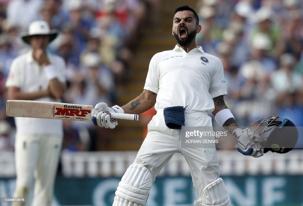 TOPSHOT - India's Captain Virat Kohli celebrates his century on the second day of the first Test cricket match between England and India at Edgbaston in Birmingham, central England on August 2, 2018. (Photo by ADRIAN DENNIS / AFP) / RESTRICTED