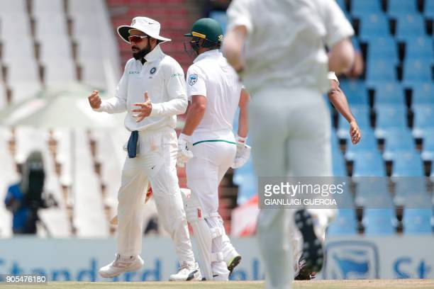 India's captain Virat Kohli celebrates the dismissal of South African batsman AB de Villiers during the fourth day of the second Test cricket match...