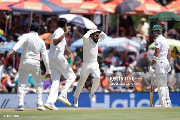 India's captain Virat Kohli celebrates the dismissal of South Africa's Aiden Markram during the first day of the second Test cricket match between...