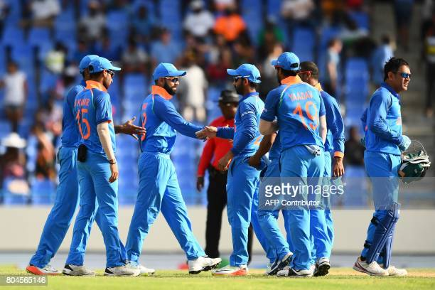India's captain Virat Kohli celebrates with teammate after defeating West Indies at the end of the third One Day International match at the Sir...