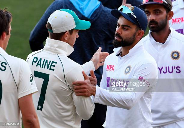 India's captain Virat Kohli congratulates Australia's captain Tim Paine on the third day of the first cricket Test match between Australia and India...
