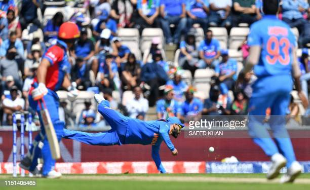 India's captain Virat Kohli dives for an attempted catch during the 2019 Cricket World Cup group stage match between India and Afghanistan at the...