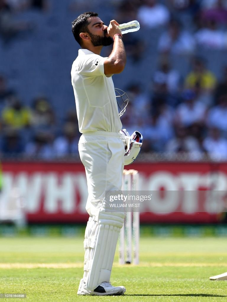 India S Captain Virat Kohli Drinks Water During Day Two Of