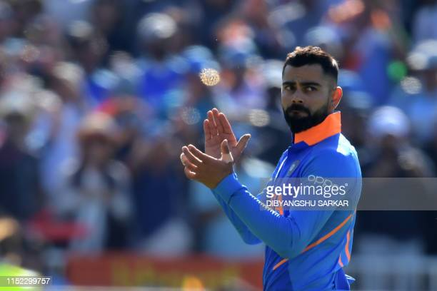 India's captain Virat Kohli gestures at end of play during the 2019 Cricket World Cup group stage match between West Indies and India at Old Trafford...