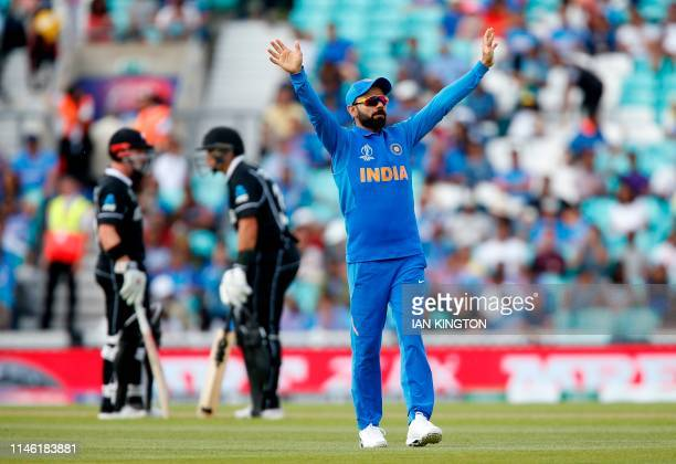India's Captain Virat Kohli gestures whilst fielding during the 2019 Cricket World Cup warm up match between India and New Zealand at The Oval in...