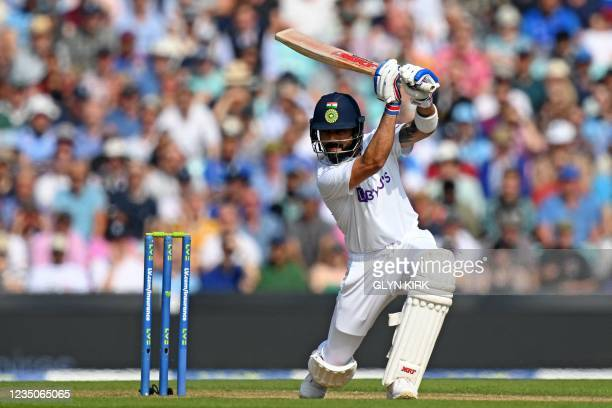 India's captain Virat Kohli hits a boundary off the bowling of England's James Anderson during play on the fourth day of the fourth cricket Test...