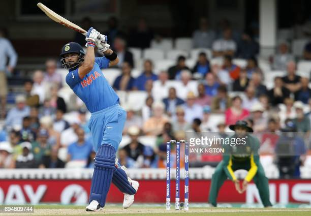 India's captain Virat Kohli hits a six during the ICC Champions Trophy match between South Africa and India at The Oval in London on June 11 2017...