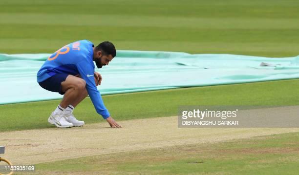 India's captain Virat Kohli inspects the pitch during a training session at Headingley Stadium in Leeds northern England on July 5 ahead of their...
