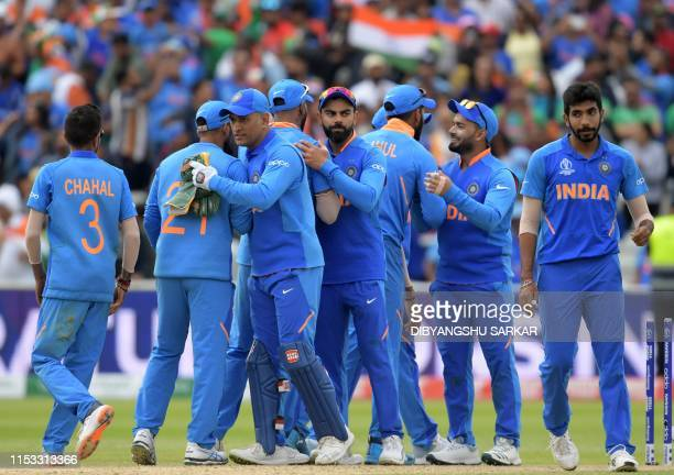 India's captain Virat Kohli leads his players as they celebrate after victory in the 2019 Cricket World Cup group stage match between Bangladesh and...