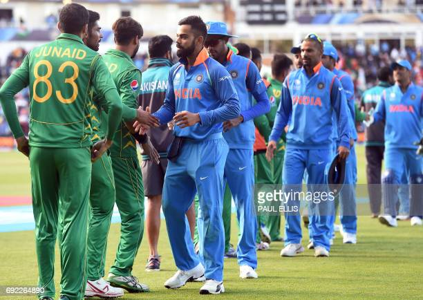 India's captain Virat Kohli leads his teammates as they shakes hands with Pakistan players after the ICC Champions trophy match between India and...