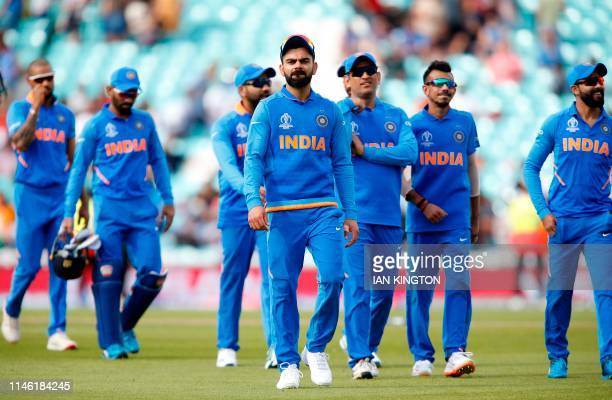 India's Captain Virat Kohli leads the team off the field of play after India are beaten by 6 wickets during the 2019 Cricket World Cup warm up match...
